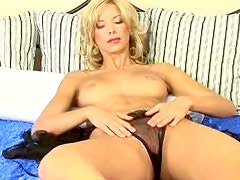 Blonde Milf Penetrates Her Shaved pussy With A Big Sex Toy