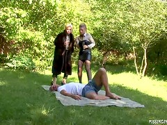 Pissing On Two Hot Babes In Outdoors Threesome