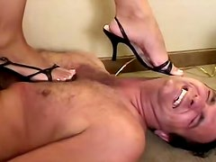 Busty brunette in black stockings is punishing her brave fucker