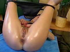 Stretching her pussy and ass with hands and big dildo