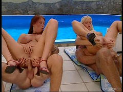 Blonde and Redhead Sluts Getting Anal Sex By The Pool In MMFF Foursome
