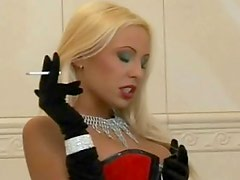 Blonde Mistress in red boots smoking and dominating