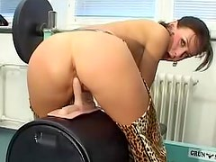 Chick in animal print chaps sits on toy