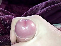 she gently plays with my uncut cock.