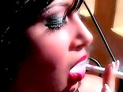 Brunette smokes in red lipstick