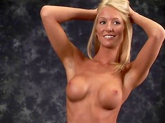Smiling cute blonde shows her tits