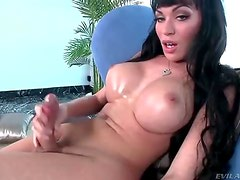 Dark haired tranny with massive tits stroking her massive cock