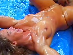 Girl coated in oil is fucked hard