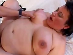 Huge belly bitch in stockings laid