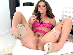 Lovely Brunette Wearing Pink Lingerie Plays With A Black Sex Toy