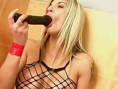 Crazy slut enjoying a black dildo