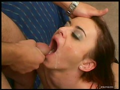 Sexy Brunette Lays On A Bed As She Swallows A Thick Cock