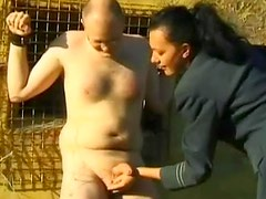 Man bound outdoors and humiliated