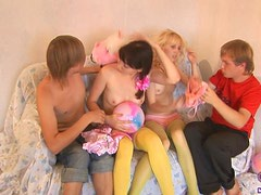 Skinny teen cuties make foursome fuck