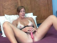She bares her big tits and toys her hot vagina