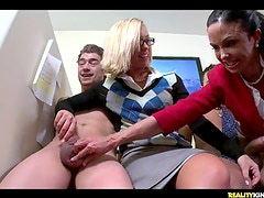 The girls are jacking the chaps off and then they give thEm oral-stimulations onto the desk in the office.