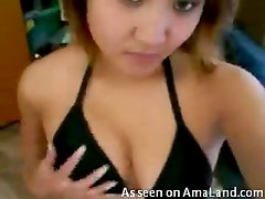 Asian chick teasing with her tits