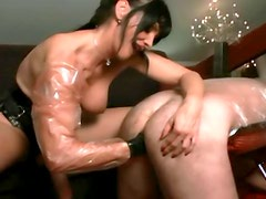 Mistress strapon fucks and fists his asshole