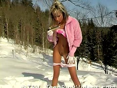 Blonde Babe Playing with Snow and her Moist Pussy Outdoors