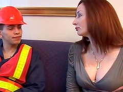 Big breasted redhead MILF fucks with a worker