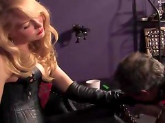 Dominatrix in leather gets rough with her subject