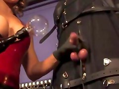 Dominas tease subject with handjob during punishment