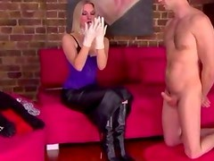 Domina teasing her worthless subject with gloves