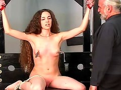 Tattooed girl in nipple torture scene