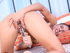 Kitty plays with the glass dildo