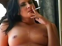 She smokes as she sucks cock