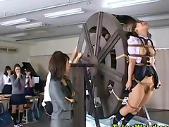 Asian slut tied to waterwheel and taunted