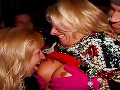 two women suck each other's tits at mardi gras