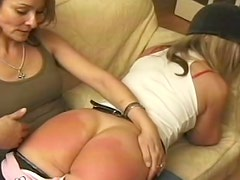 Mean mistress spanks two submissive asses