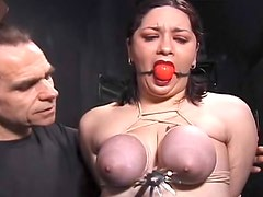 Tits tortured on gagged girl in dungeon