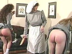 Spanking sweet young ladies on bare asses