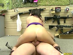 BElla Bangs Hunter good onto tthis chab Sales floor of the gun store