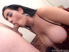 Busty brunette chick gives titjob adn gets pounded