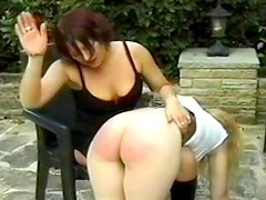 Sexy ass spanked and caned outdoors