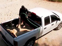 Rubber girl water play in the truck bed
