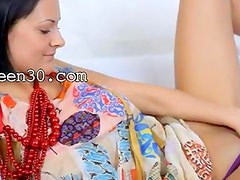 Busty model in beads dildoing snatch
