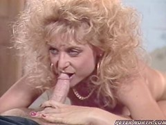 Hot Nina Hartley is having sex with some blonde guy
