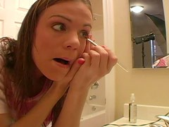 Cute teen does her makeup and talks dirty