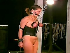 Gagged and tied girl in dungeon