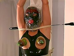 Latex wrapped dungeon submissive bound