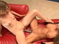Dildo shared between two hot pussies