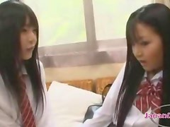 2 Schoolgirls Kissing Passionately Sucking Tongues Patting On The Rattan Couch In The Roo