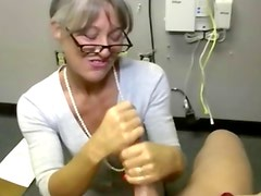 Mature doctor on her knees wanking off male