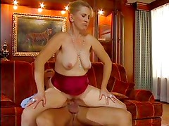 SEXY MOM n77 blonde mature on a red sofa