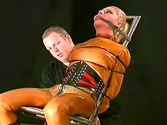 Sexy rubber girl in kinky bondage