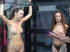 Kinky girls light BDSM play in dungeon